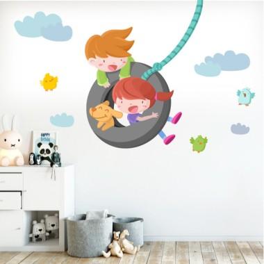 Vinilos infantiles decorativos - Niño y niña en el columpio