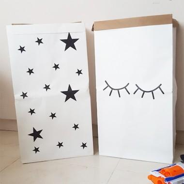 Sac organitzador de paper - Ullets. PETIT Sacs organitzadors de paper Petit sac de paper per emmagatzemar objectes. Una fantàstica idea per tenir les coses ordenades i a la mateixa vegada decorar les habitacions dels nens. Sacs súper divertits, resistents i amb gran capacitat.Mida del sac:31x61x16 (ample x alt x base) Material: 2 capes de paper kraft (exterior blanc i interior ocre) vinilos infantiles y bebé Starstick