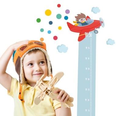 Avió confeti - Vinil mesurador infantil Mesuradors Vinil mesurador a joc amb el vinil de l'avió confeti. Vinils infantils per enganxar i decorar, de manera original, les habitacions dels petits de la casa.  Mides del vinil Mida de la làmina: 135x24 cm Mida del muntatge:135x60 cm  Inclou 16 etiquetes per marcar el que vulguis! vinilos infantiles y bebé Starstick